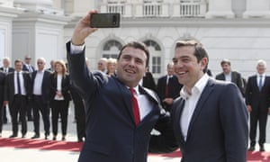 The North Macedonian prime minister, Zoran Zaev (left), takes a selfie with his Greek counterpart, Alexis Tsipras
