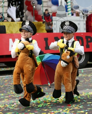 Children take part in the London New Year's Day Parade.
