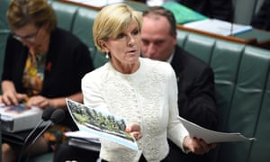 Minister for Foreign Affairs Julie Bishop holds up a photo of the island of Eneko in the Marshall Islands to mock Tanya Plibersek on Tuesday.