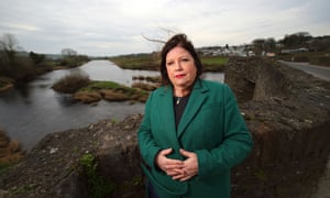 Marie Brown, director of Foyle Women's Aid, Northern Ireland, stands on the Clady border bridge connecting the County Tyrone village of Clady with County Donegal