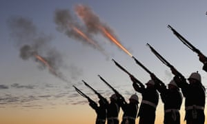 Members of the Albert Battery shoot a volley of fire during the Anzac Day dawn service at Currumbin Surf Life Saving Club, Gold Coast, Queensland.
