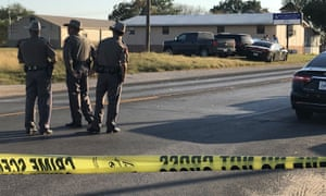 Police block a road in Sutherland Springs,.