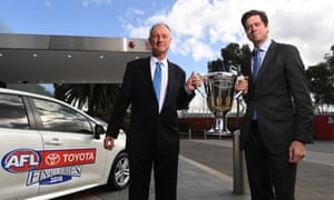 Sean Hanley of Toyota (left) and AFL CEO Gillon McLachlan with the 2018 AFL premiership cup.