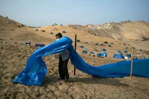 Chorrillos, Peru: a man marks a plot of land on the Morro Solar amid the coronavirus outbreak