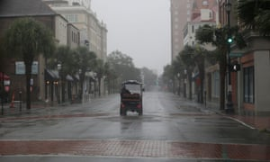 A golf cart travels down a deserted King Street during Hurricane Dorian in Charleston, South Carolina