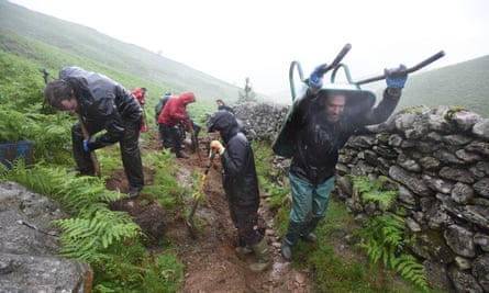 Volunteers help the Fix The Fells team repair a stretch of damaged path.