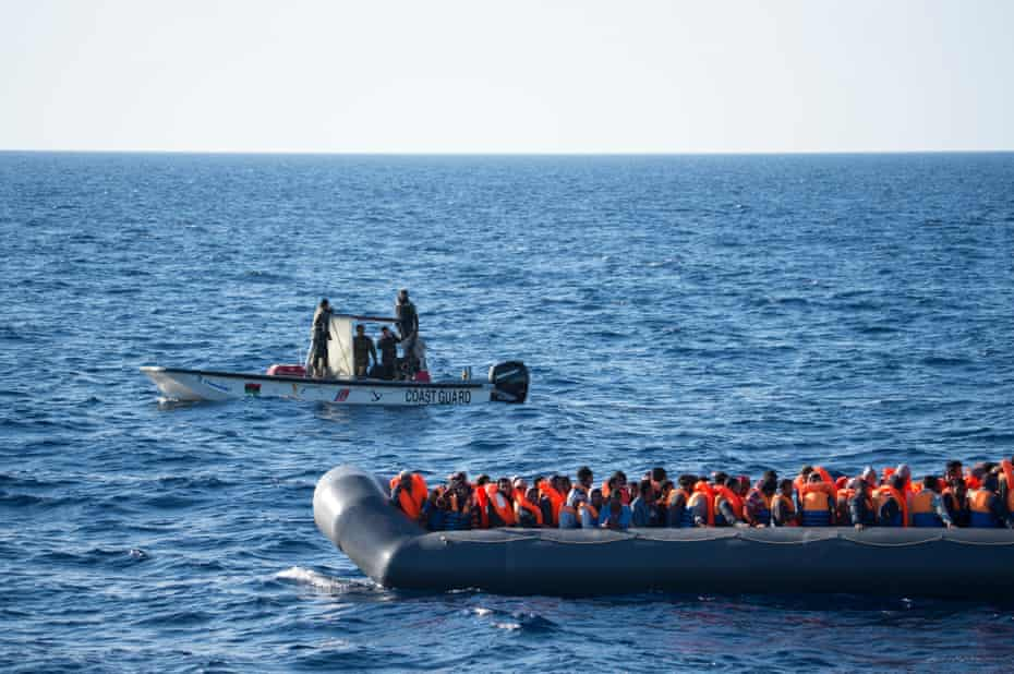 A Libyan coastguard vessel intercepts a rubber boat with around 150 people onboard off the Libyan coast