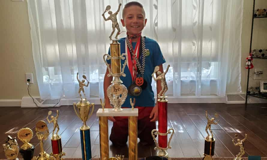 Teo Davidov with some of the trophies he has won during his tennis career