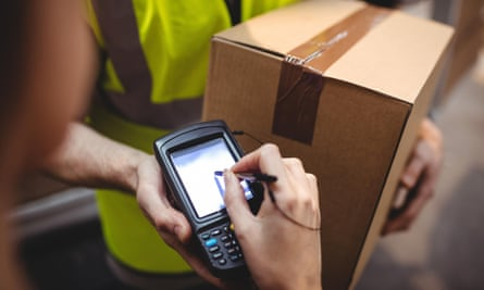 Deliveries are programmed into a handheld device that records a courier's progress.