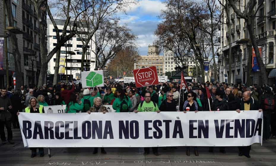 Protesters carry a banner that reads 'Barcelona is not for sale' during a demonstration in La Rambla.
