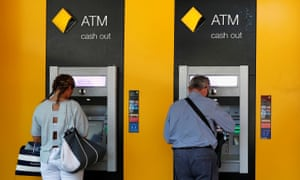 People withdraw cash from ATMs