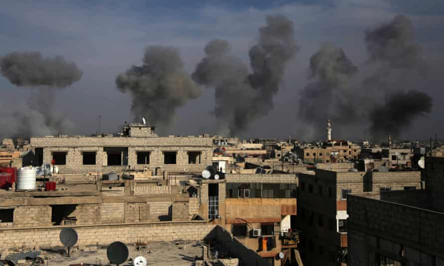 Smoke billows after airstrikes by regime forces on the town of Douma in the eastern Ghouta region.
