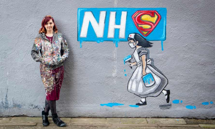 Rachel List with her mural on the side of Horse Vaults pub in Pontefract, Yorkshire.