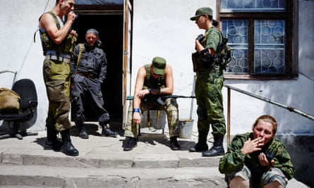 Pro-Russian rebels hang around at their base in the frontline village Pervomaisk.