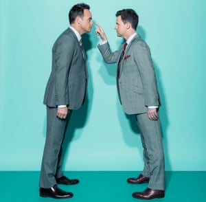 Entertainers Ant and Dec standing facing each other and leaning in