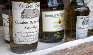 Bottles of calvados in a shop window in the Pays d'Auge region of Normandy