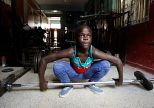 Nairobi, KenyaChanel Okoth, daughter of the Kenyan weightlifter Mercy Obiero, prepares to lift weights during a training session at a gym within Umoja estate
