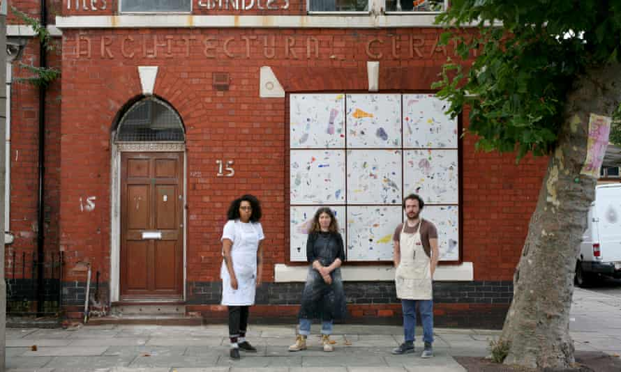 Sumuyya Khader and Anna Johnston of Granby Workshop with Lewis Jones of Assemble in painting overalls standing in front of number 15