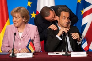 October 2008: Berlusconi with the French president, Nicolas Sarkozy, and German chancellor, Angela Merkel, during a news conference after a summit at the Élysée palace to discuss the international financial crisis