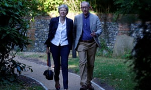 Theresa May and her husband Philip arriving at church in Sonning, Berkshire.
