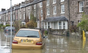 Cars have been swept along flooded streets.