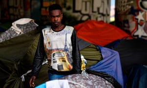 A migrant leaving a camp in Paris