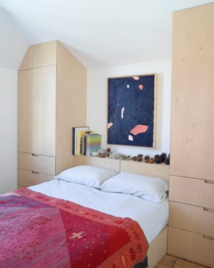 The main bedroom, with bespoke wardrobes and shelf of mementos.
