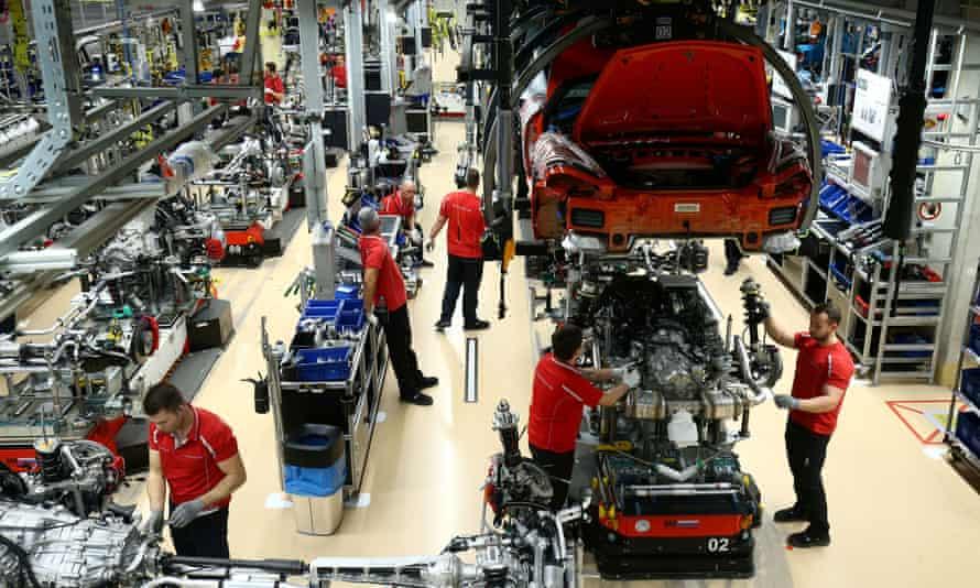 Employees of German car manufacturer Porsche assemble sports cars at the factory in Stuttgart-Zuffenhausen