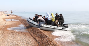 Kingsdown beach, EnglandA group of people thought to be migrants arrive in an inflatable boat near Dover in Kent, after crossing the English Channel