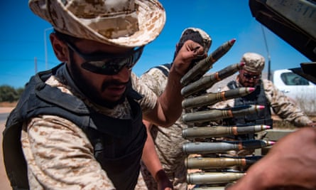A fighter loyal to the UN-backed government in Libya carries a bullet belt