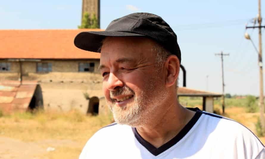 Tibor Varga, a protestant pastor in the Serbian city of Subotica, outside the abandoned factory where refugees shelter before attempting to cross into Hungary.