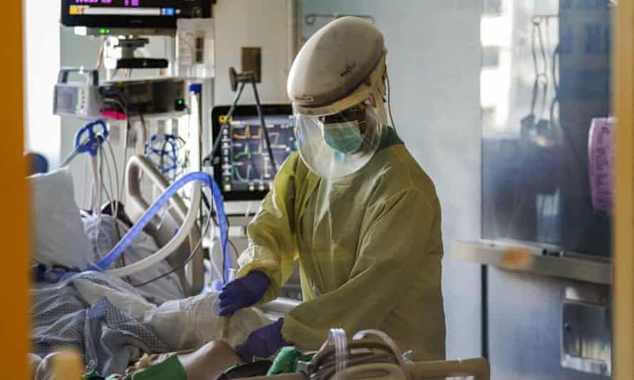 A healthcare worker tends to a Covid-19 patient in the intensive care unit at Santa Clara Valley medical center in San Jose, California.