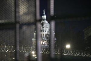 Razorwire and fences surround the Capitol building