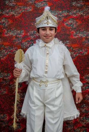 A boy wears his traditional costume with pride