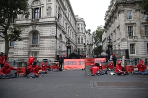 Greenpeace members staging a protest outside Downing Street today against the proposed Cambo oil field devevloopment off the west coast of Shetland.