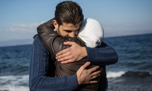 A migrant couple hug each other after arriving in Lesbos from Turkey.