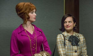 Christina Hendricks as Joan Harris and Elisabeth Moss as Peggy Olson in Mad Men.