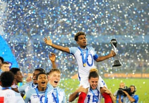 England's Angel Gomes celebrates with the trophy.