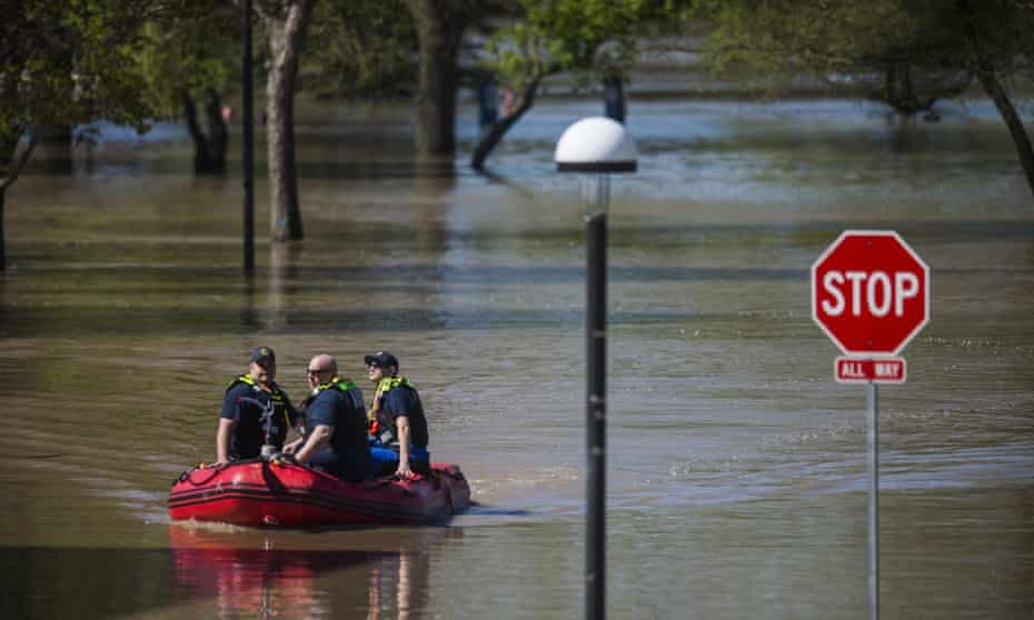 Law enforcement officers patrol downtown Midland, Michigan in a rescue boat Thursday.