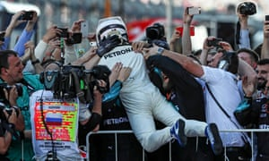 An overjoyed Valtteri Bottas celebrates with his Mercedes team after his first ever Grand Prix victory.