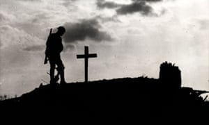 A British soldier at a comrade's grave in Belgium in 1917