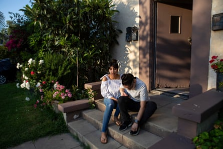Karen and her wife Alex share a moment together on Karen's porch in Orange County, California where she grew up.