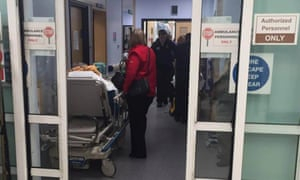 People waiting on trolleys, yesterday evening, in the A & E department at the Royal Glamorgan Hospital