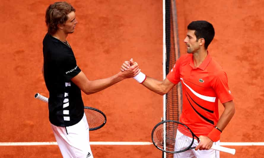 Alex Zverev and Novak Djokovic shaking hands at the net at the end of a match