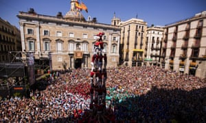 Performers form a human tower at a demonstration in in Barcelona