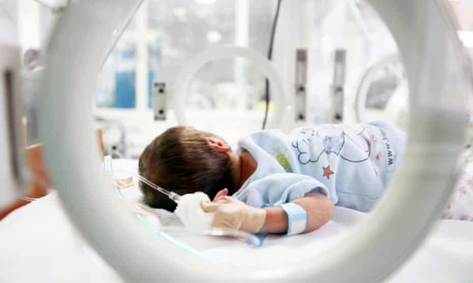 A newborn baby in hospital.