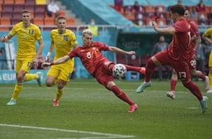 Ezgjan Alioski of North Macedonia scores his team's first goal.