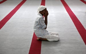 A man prays at a mosque in Kochi, India