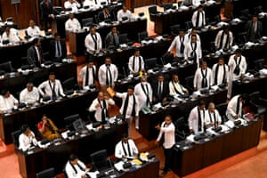 Colomba, Sri Lanka Opposition legislators wear black shawls protest in parliament as convicted murderer Premalal Jayasekara (unseen) takes oaths as a member of parliament . Jayasekara becomes the first convict facing a death sentence to become a legislator in Sri Lanka