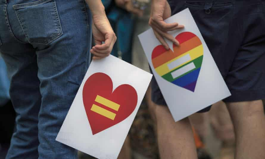 People hold banners during a protest by gay rights activists